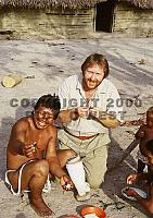 Piaroa shaman and Rick West eat cooked giant tarantulas, Venezuela